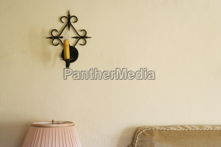 wrought iron wall sconce with candle
