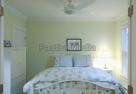 blue and yellow bedspread on bed