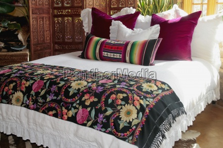 colorful bed runner and pillows on