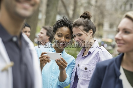 people outdoors in the city in