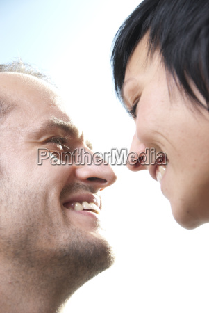 man and woman laughing side by