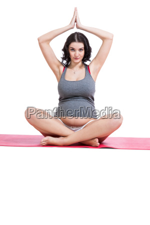 attraktive schwangere junge frau macht yoga