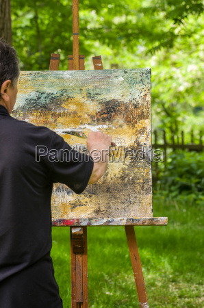 artist paints an abstract image