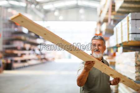 man buying construction wood in a