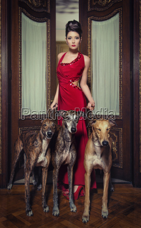 red lady with greyhounds
