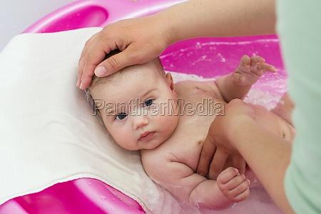 adorable baby having bath