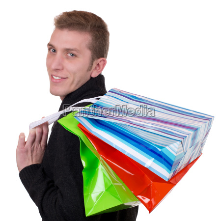laughing young man shopping with bags