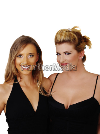 two blond women smiling in black