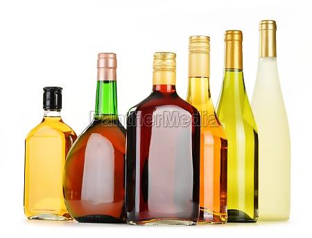 flaschen sortierte alkoholische getraenke auf weiss