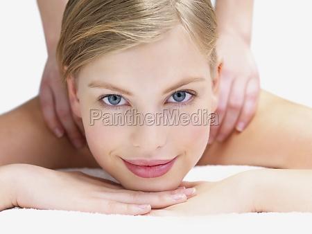 young female getting shoulder massage