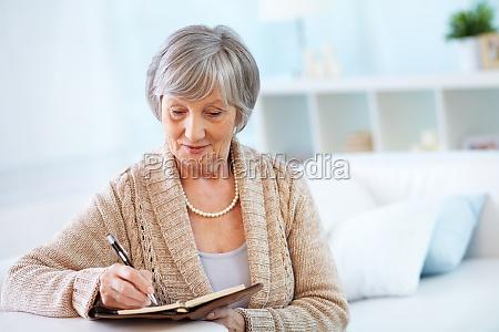 female making notes