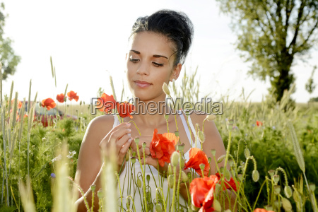 young woman with poppy flower