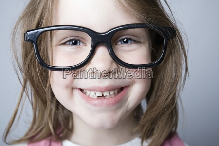 happy geeky child smiling at the