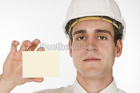 man hold card