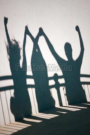 shadows of happy people