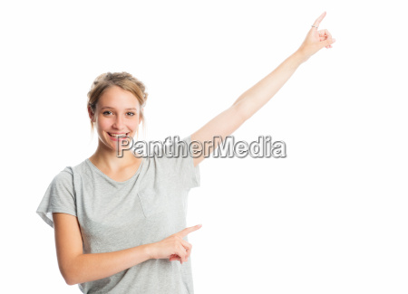 blond girl points finger upwards