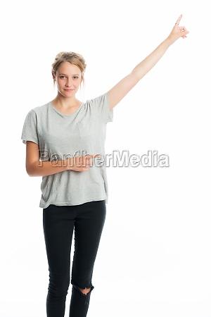 blonde girl shows a finger upwards