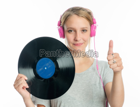 blond girl with headphones holding a