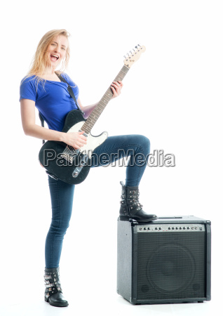 blond girl with guitar and amplifier
