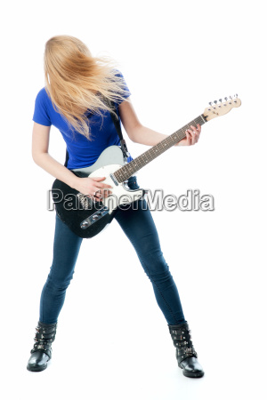 blond girl playing with an electric