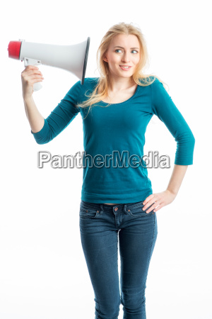 blond girl listening into a megaphone
