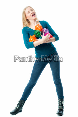 blond girl with piggy banks