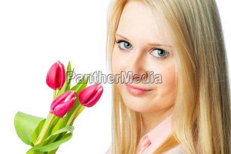 young blonde girl holding bouquet of