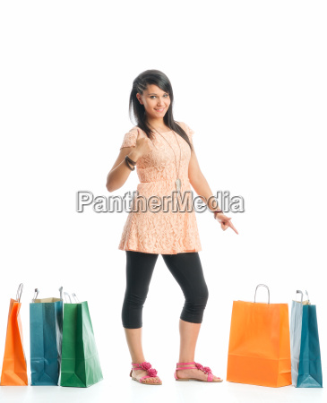 young girl with paper bags