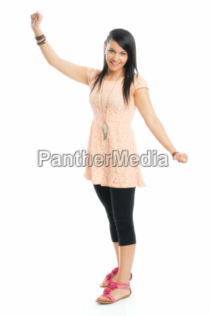 black haired girl pointing upwards