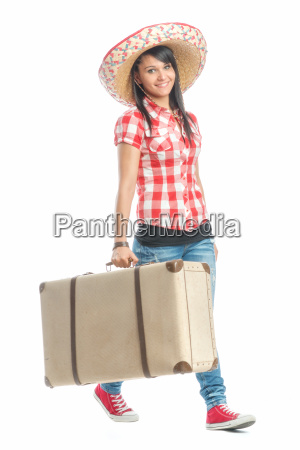 girl with sombrero carrying a suitcase