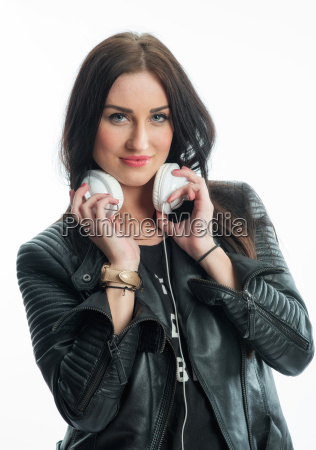 woman in leather jacket with headphones