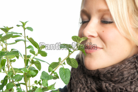 woman smell inhale peppermint sick person
