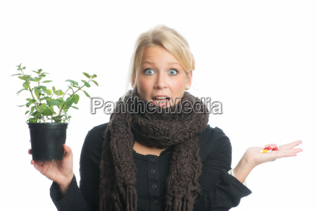 woman with medical plant and capsules
