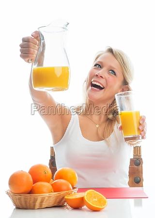 blond woman with orange juice