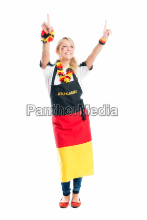 cheering blond football fan with fan