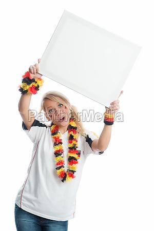 blonder football fan holding a poster