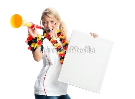 blonde football fan with vuvuzela holding