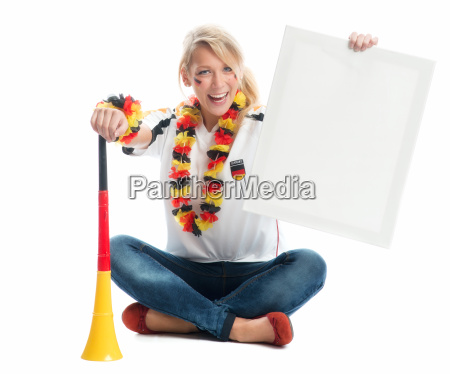 blond football fan with vuvuzela is