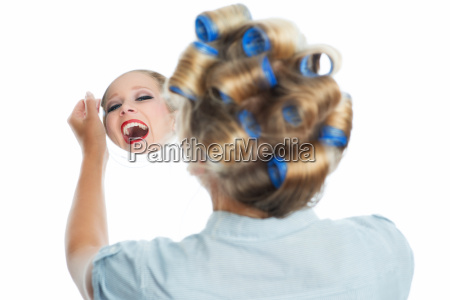 housewife looks in the mirror