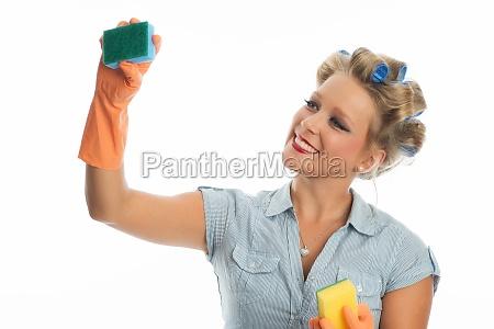 housekeeper with sponge