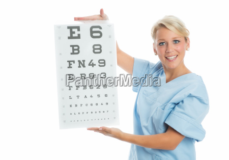 doctor holds eye chart