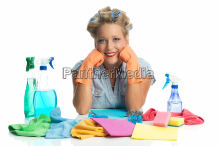 housewife with cleaning utensils