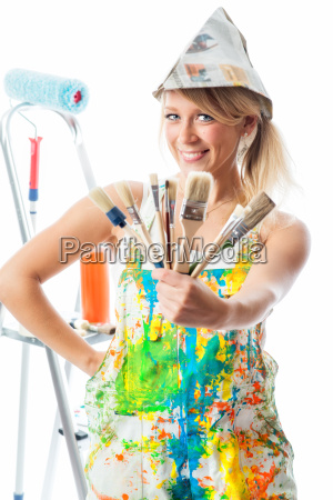 female painter with different brushes