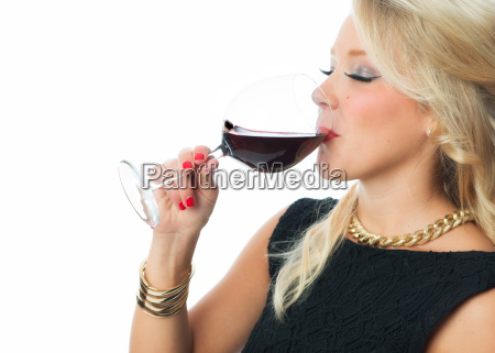 blond woman with glass of red