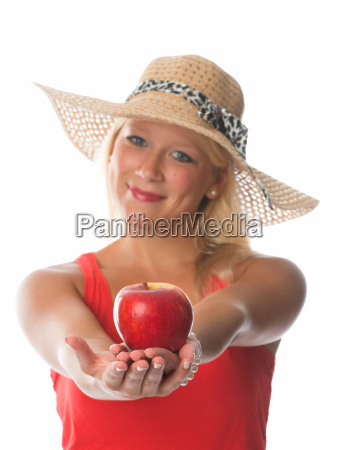 blond woman holding a red apple