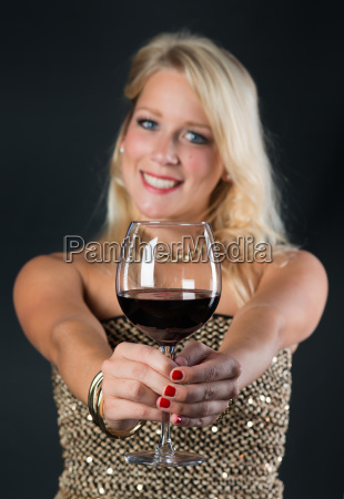 elegant woman with red wine in