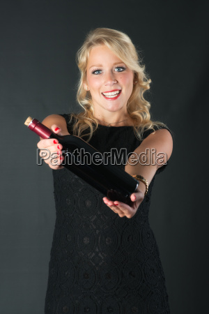 beautiful blond woman with red wine