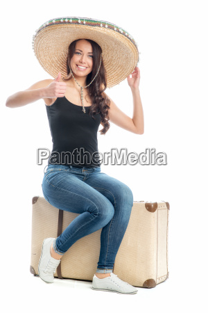 woman with suitcase and sombrero