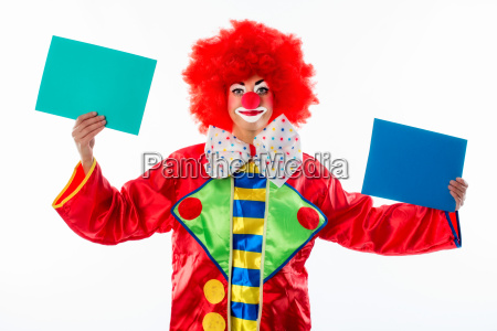 clown holding cardboard cards