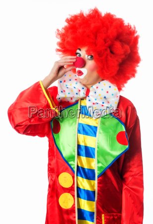 clown touches his nose